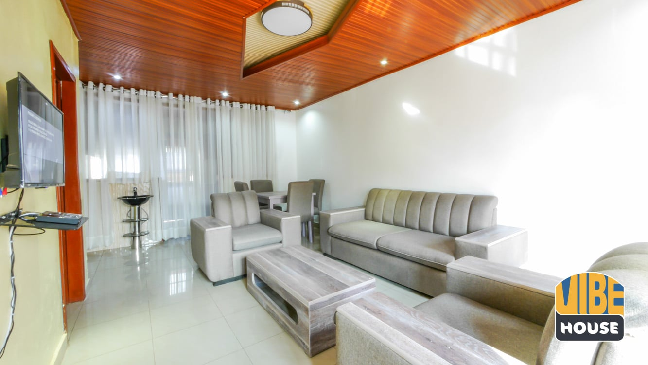 Living room with modern furniture - house for rent in Kacyiru, Kigali