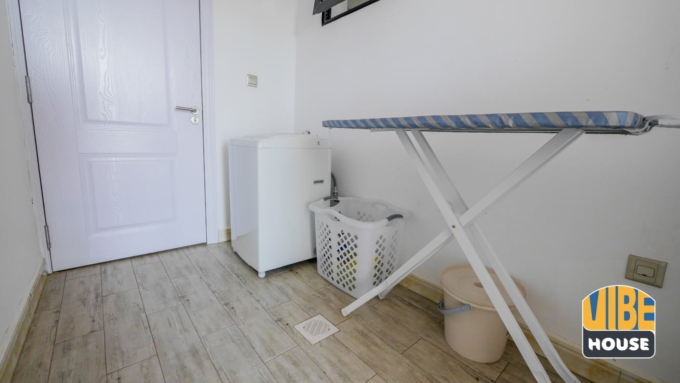 Laundry room with waching machine and ironing board