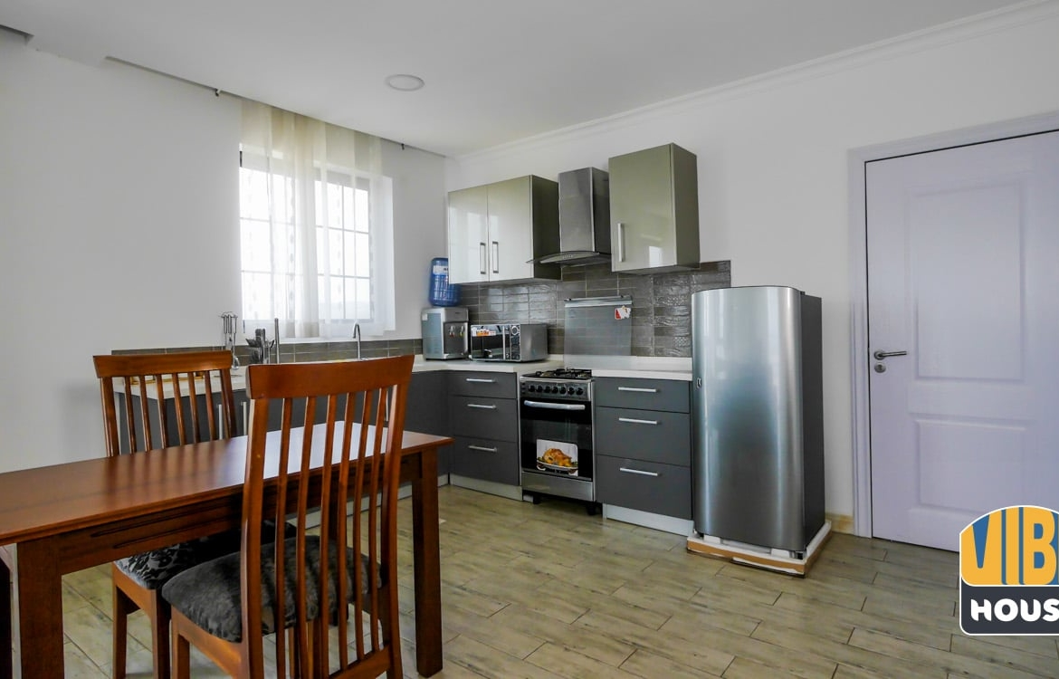 Furnished open-plan kitchen and dining area - Luxurious apartment for rent in Kigali