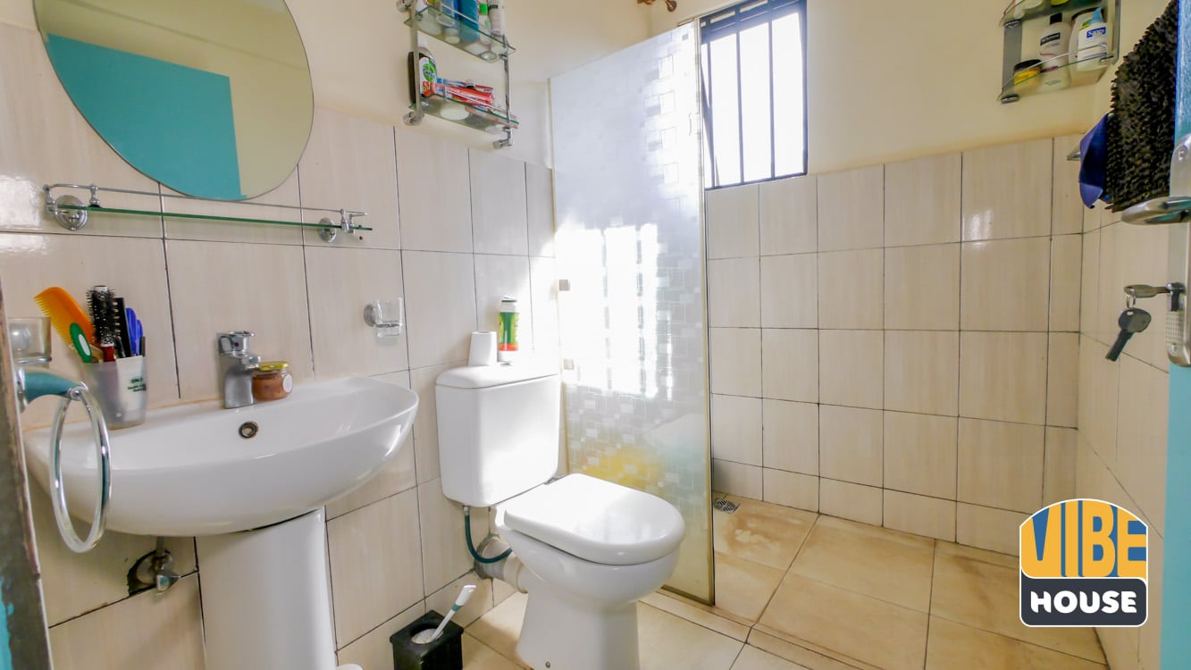 Beige-tiled bathroom with a shower