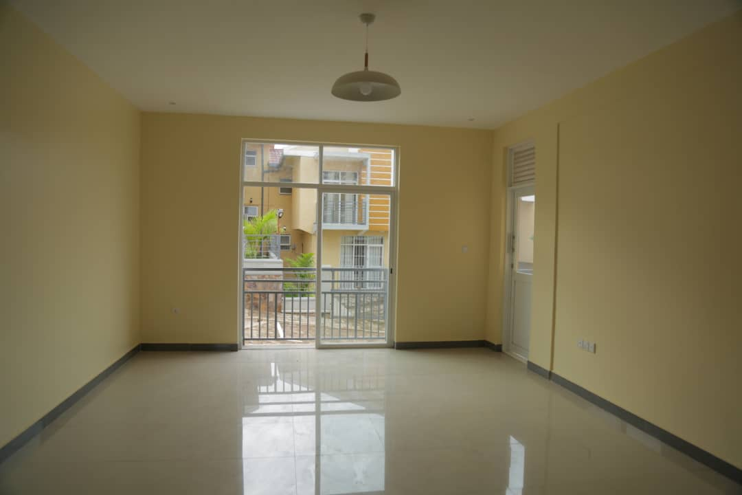 Well-lit living room in apartment for sale in Nyarutarma, Kigali